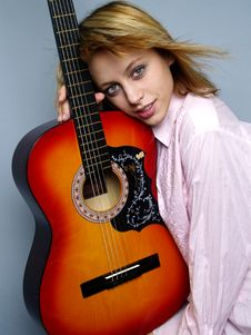 Free Beautiful Girl With Guitar Royalty Free Stock Photography - 3129097