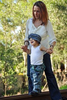 Free Young Mother Helping Toddler Baby Boy To Walk Stock Image - 31210511
