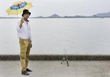 Senior Fisherman Catches A Fish Royalty Free Stock Image