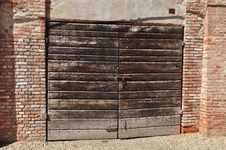 Free Old Wooden Gate And Brick Wall Stock Image - 31241301