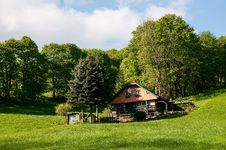 Cottage, Meadow And Trees