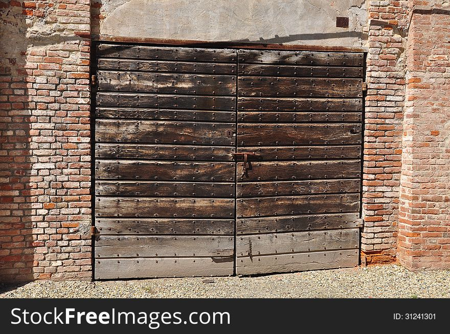 Old wooden gate and brick wall