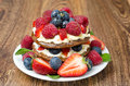 Free Pancake With Whipped Cream And Fresh Berries On The Wooden Table Royalty Free Stock Images - 31262409