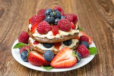 Pancake With Whipped Cream And Fresh Berries On The Wooden Table Royalty Free Stock Images