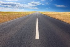 Driving On An Empty Road At Bright Sunlight Royalty Free Stock Photo