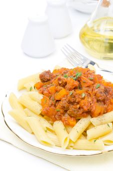 Penne Pasta With Sauce Of Beef, Tomato And Pumpkin On A Plate Royalty Free Stock Photography