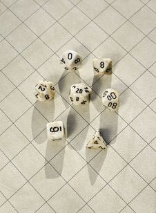 Free Polyhedral Dice On Blank Roleplay Game Grid Stock Photography - 31299072