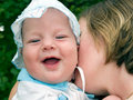 Free Mother Kissing Laughing Baby Stock Photos - 3135633
