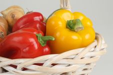 Basket With Peppers Stock Photography