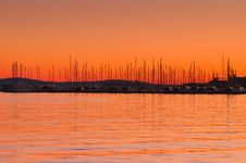 Free Orange Sky And Boats In Horizon Royalty Free Stock Images - 31313699