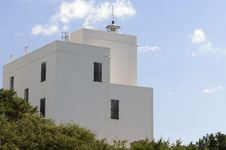 Lighthouse Of Capo Comino Stock Images