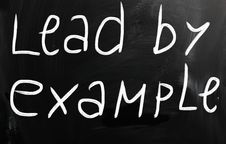 Lead By Example Handwritten With White Chalk On A Blackboard Stock Image
