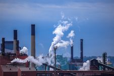 Smoking Chimney-stalks Of Industrial Plant Stock Photo