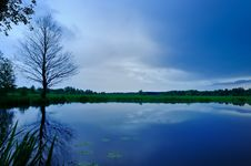 Calm Lake And Dark Blue Sky In The Evening Stock Photography