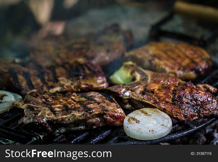 Meat steak on grill