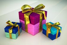 Free Three Gifts With Golden Ribbons Stock Photos - 31381023