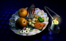 Free Decorated Christmas Dish With Fruit And Sweets, Beside A Candle Stock Photo - 31381740