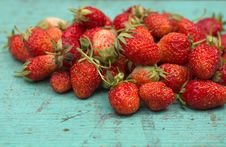Strawberries On A Wooden Surface Royalty Free Stock Photography