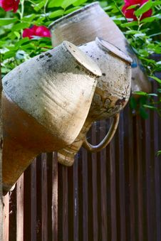 Old Jugs On A Rustic Fence Stock Photography