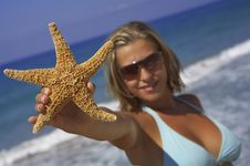 Woman With Starfish Stock Photography