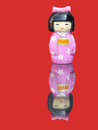 Free Porcelain Chinese Figurine With Mirror Image  On A Red Background Royalty Free Stock Photos - 31405288