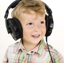 Portrait Of Little Cute Boy In Earphones Royalty Free Stock Images