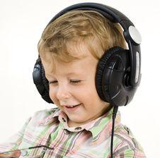 Free Portrait Of Little Cute Boy In Earphones Stock Photo - 31403400