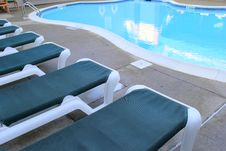 Free Lounge Chairs At The Poolside Royalty Free Stock Image - 31406726