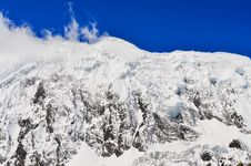 Snow Mountain Peak With Glacier, Clouds And Blue Sky Royalty Free Stock Photos