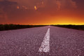 Free Driving On An Empty Road At Beautiful Sunset Royalty Free Stock Photography - 31426847