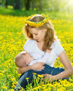 Free Mother  Feeding Her Baby In Nature Green Meadow With Yellow Flow Stock Photography - 31427052