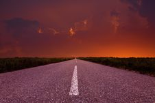 Free Driving On An Empty Road At Sunset Stock Image - 31426901