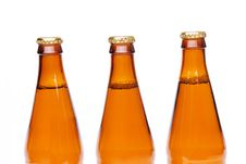 Free Three Brown Neck Bottles Stock Photography - 31427722