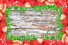 Frame Of Strawberries And Grass And Wooden Background. Royalty Free Stock Photo