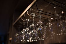 Free Glasses Hanging Over Bar Rack Royalty Free Stock Image - 31466396
