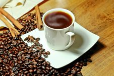 Hot Coffee With Beans And Herbal Royalty Free Stock Photo