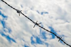Free Barbed Wires Against Cloudy Sky Stock Photo - 31485210
