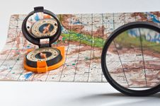 Compass And A Map. Royalty Free Stock Images