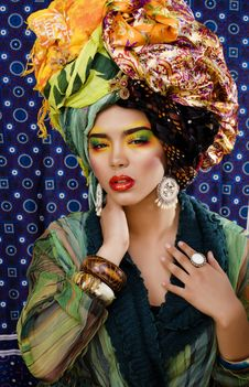 Free Woman With Creative Make Up, Many Shawls On Head Like Cubian Woman Royalty Free Stock Image - 31498226