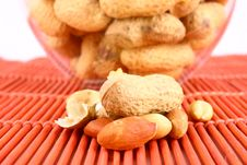 Free Some Peanuts Over Red Backgrou Royalty Free Stock Photos - 3158508