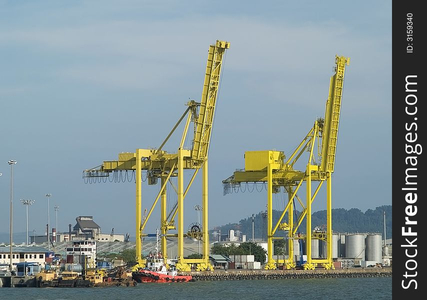 Two container cranes in a harb