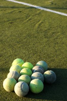 Free Group Of Tennis Balls In Front Of White Line On Court Stock Image - 31511071