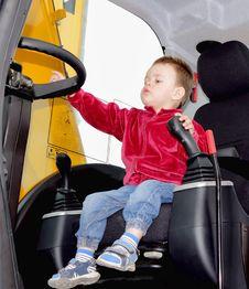 Free Boy At The Wheel Of Excavator Stock Photo - 31516440