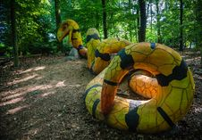 A Yellow And Black Concrete Snake Stock Photo