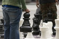 Free Man Moves Piece People Playing Giant Chess Game Sidewalk Downtow Royalty Free Stock Images - 31533739