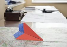 Free Paper Plane On The Aerial Map Stock Photo - 31535920