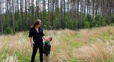 Free Pretty Young Mother Looking Down Into Smiling Son S Face While Out In Meadow Stock Photo - 31537590
