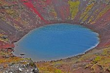 Kerid Volcano: Red Ground Stock Images