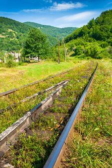 Railway Sneaking Through Mountain Near The Wilage Stock Photography