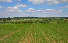 An English Summer Landscape With A Village On A Hill Royalty Free Stock Photos